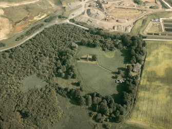General oblique aerial view of the remains of the priory and the house, taken from the N.