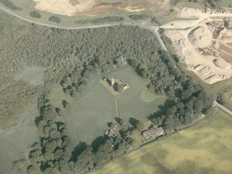 General oblique aerial view of the remains of the priory and the house, taken from the WNW.
