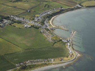 Oblique aerial view centred on the village and harbour, taken from the SE.