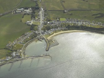 Oblique aerial view centred on the village and harbour, taken from the NE.