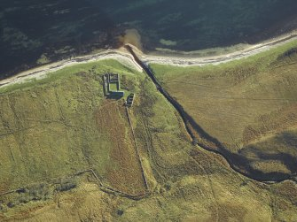 Oblique aerial view centred on the remains of the cottage, rig and sheepfold, taken from the NW.