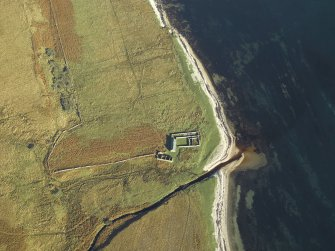 Oblique aerial view centred on the remains of the cottage, rig and sheepfold, taken from the SW.
