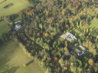 Oblique aerial view centred on the house with the garden adjacent, taken from the SE.
