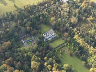 Oblique aerial view centred on the house with the garden adjacent, taken from the NE.