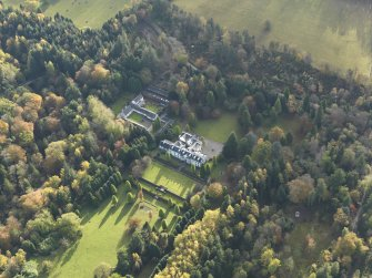 Oblique aerial view centred on the house with the garden adjacent, taken from the NW.