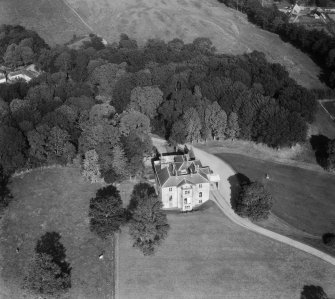 Earlston House, Borgue.  Oblique aerial photograph taken facing north-east.  Prior to its demolition in about 1954.