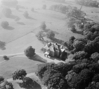 Earlston House, Borgue.  Oblique aerial photograph taken facing west.  Prior to its demolition in about 1954.