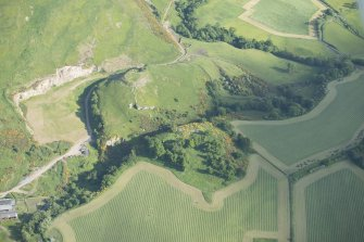 Oblique aerial view of Kay Craig under excavation with Castle Craig beyond, looking SSE.