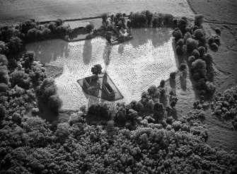 Oblique aerial view centred on the remains of Restenneth Priory with pits and a possible souterrain adjacent, looking to the W.