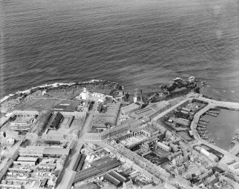 Fraserburgh, general view, showing Kinnaird Head Lighthouse and Bath Street.  Oblique aerial photograph taken facing north-east.