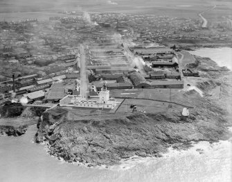 Fraserburgh, general view, showing Kinnaird Head Lighthouse and Denmark Street.  Oblique aerial photograph taken facing south-west.