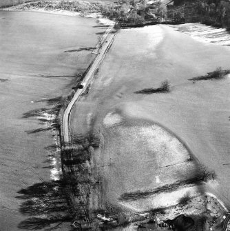 Castle Craig, oblique aerial view, taken from the WNW, showing the traces of an old road running up the centre of the photograph.