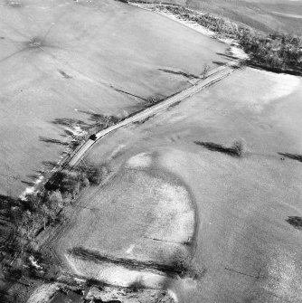 Castle Craig, oblique aerial view, taken from the WSW, showing the traces of an old road running up the centre of the photograph.