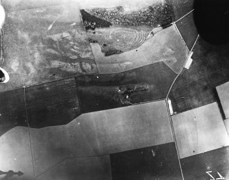 Vertical aerial view of The Chesters, Drem showing the fort, a circular palisaded settlement and a pit-alignment.