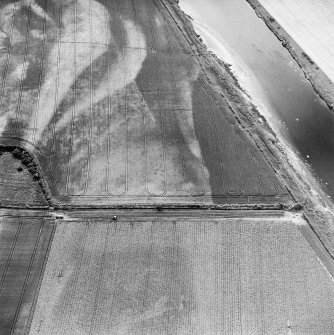 Redden, oblique aerial view, taken from the ENE, centred on the cropmarks of a possible four-poster.