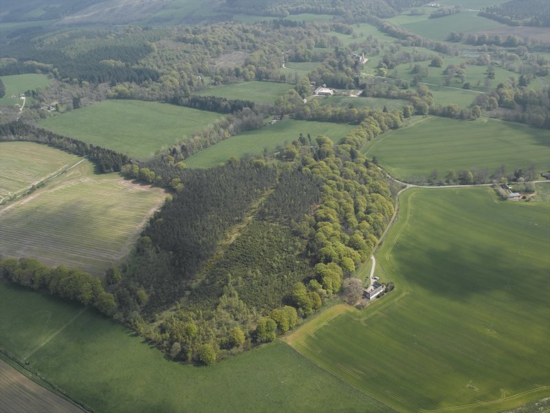 General oblique aerial view centred on Cothiemuir Wood, taken from the NW.