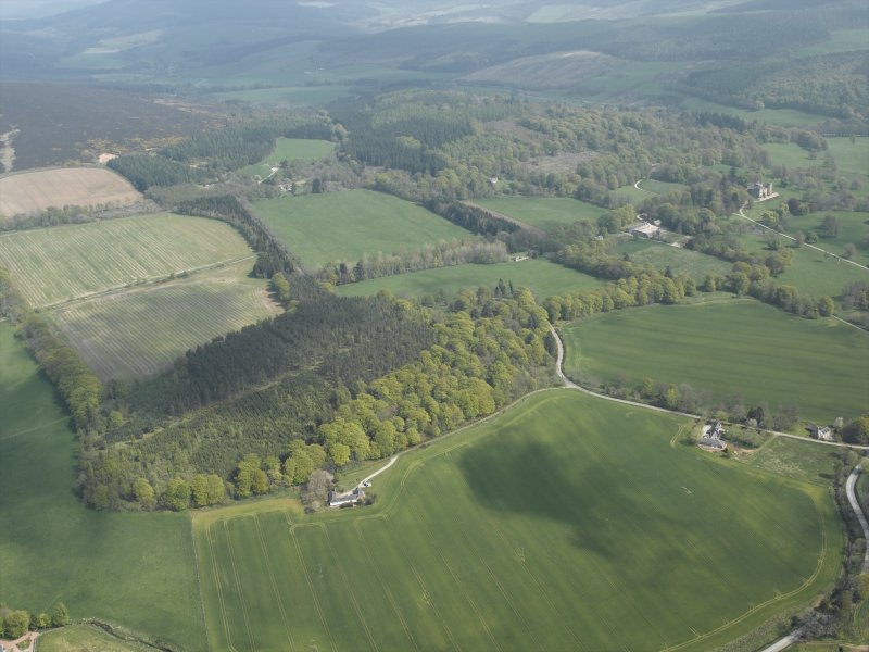 General oblique aerial view centred on Cothiemuir Wood, taken from the WNW.