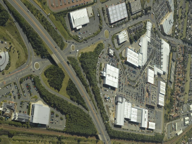 General oblique aerial view centred on the retail park, taken from the E.
