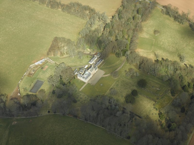 Oblique aerial view centred on the country house and gardens, taken from the SW.