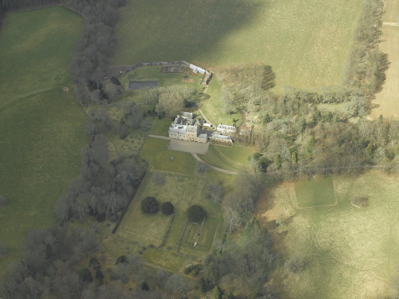 Oblique aerial view centred on the country house and gardens, taken from the SE.