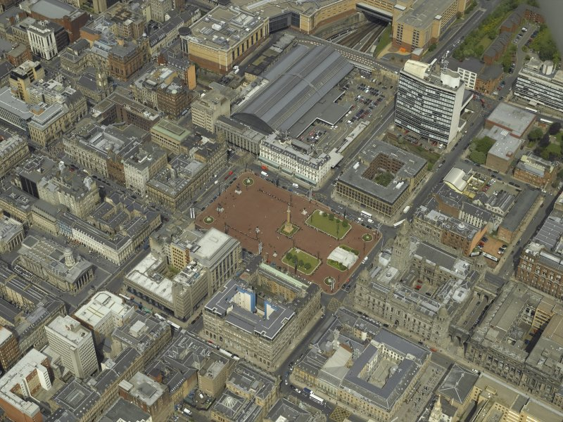 Oblique aerial view centred on the city chambers and square with the station adjacent, taken from the SSE.