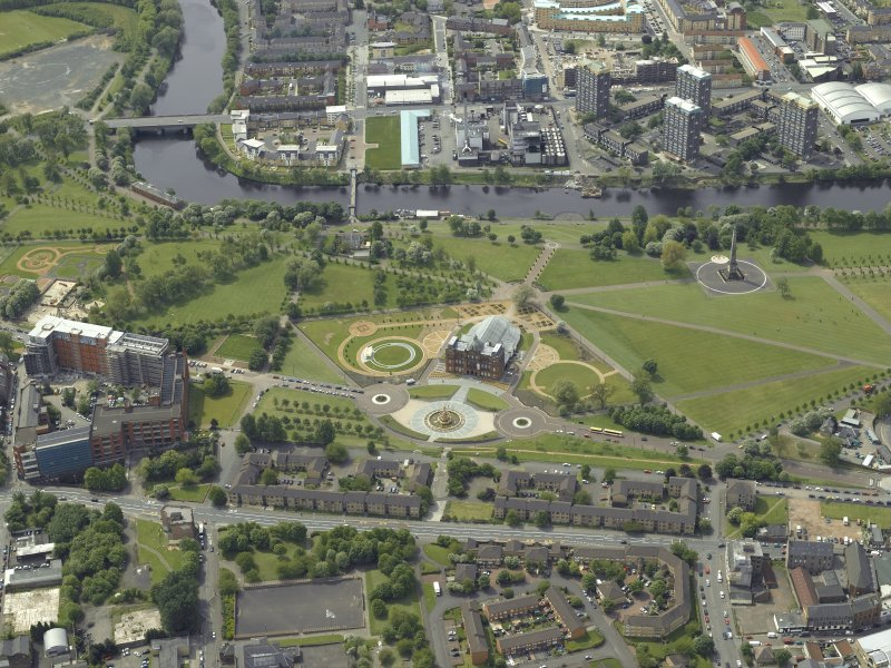 General oblique aerial view of Glasgow Green centred on the museum with the factory adjacent, taken from the NE.