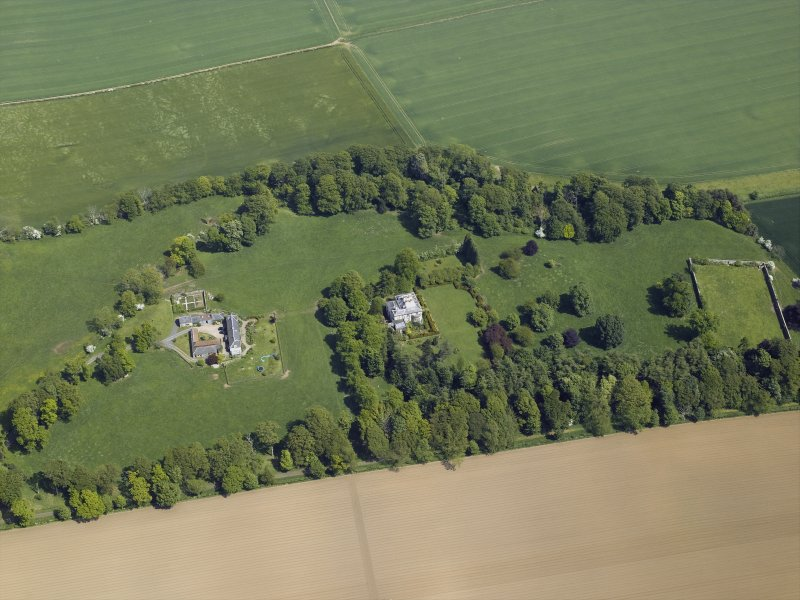 Oblique aerial view centred on the country house and stables, taken from the WSW.