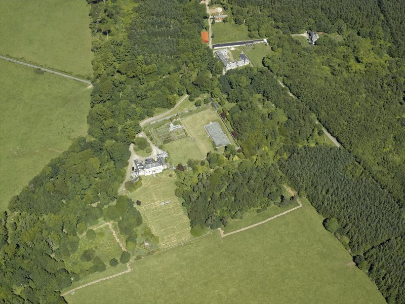 Oblique aerial view centred on the house, taken from the SE.