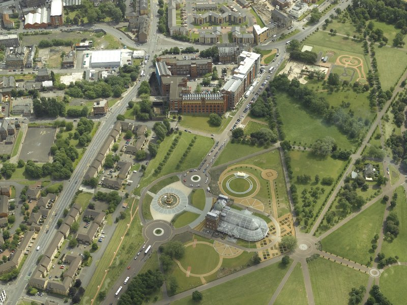 General oblique aerial view centred on Glasgow Green, the factory and the muesum, taken from the WNW.