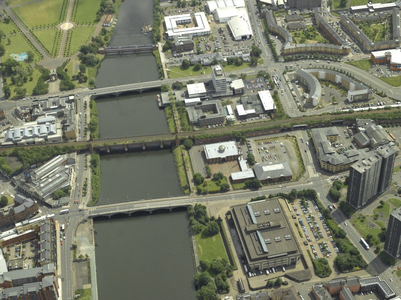 Oblique aerial view of the river centred on the bridges with the mosque adjacent, taken from the WNW.