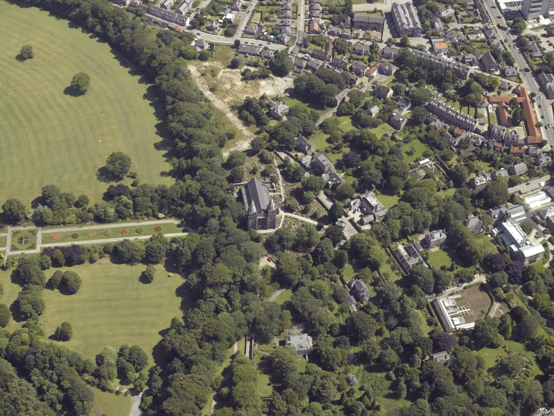 Oblique aerial view centred on the cathedral, burial ground and park, taken from the WNW.