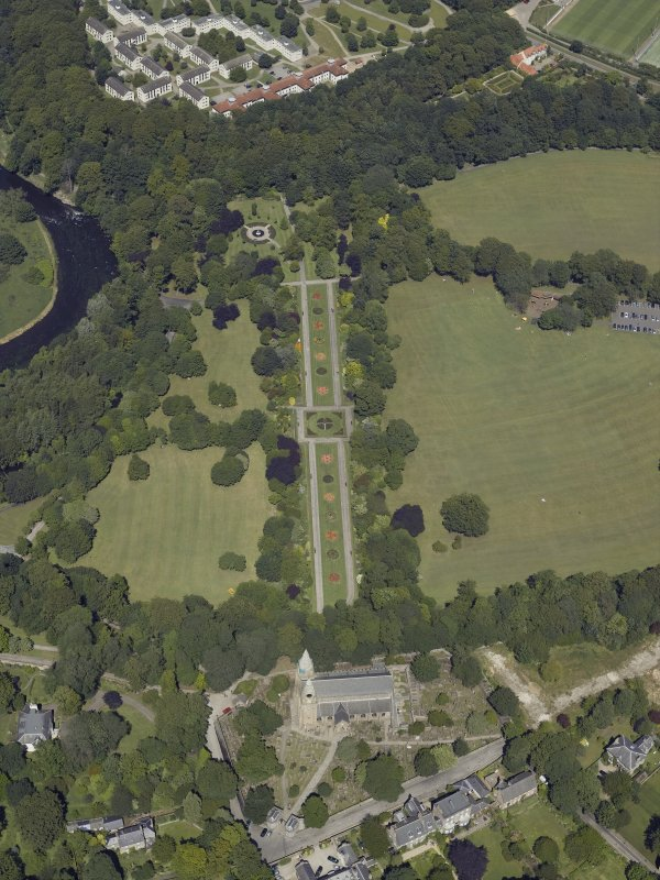 Oblique aerial view centred on the cathedral, burial ground and park, taken from the S.
