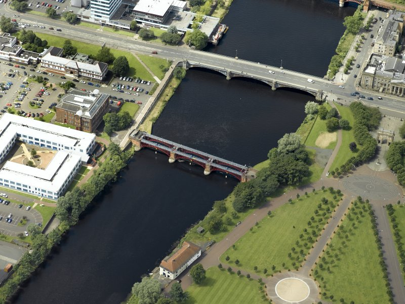Oblique aerial view of the river centred on the bridges, taken from the SW.