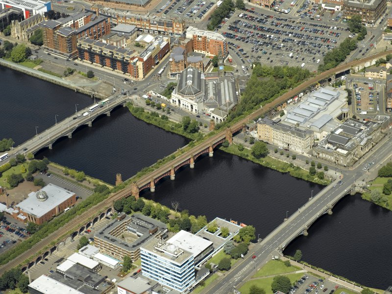 Oblique aerial view of the river centred on the bridges with the mosque adjacent, taken from the SSE.