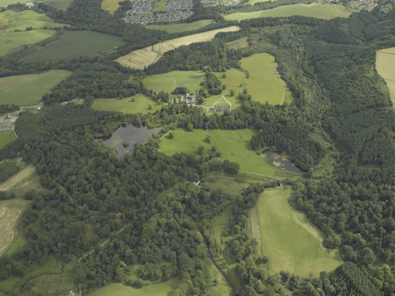 General oblique aerial view centred on the house and policies, taken from the SW.