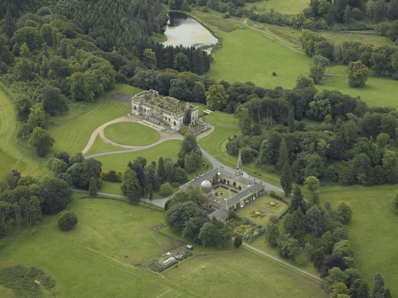 Oblique aerial view centred on the stables and the ruins of the house, taken from the N.