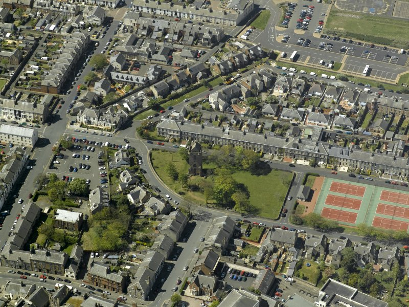 Oblique aerial view centred on St John's Tower, taken from the E.