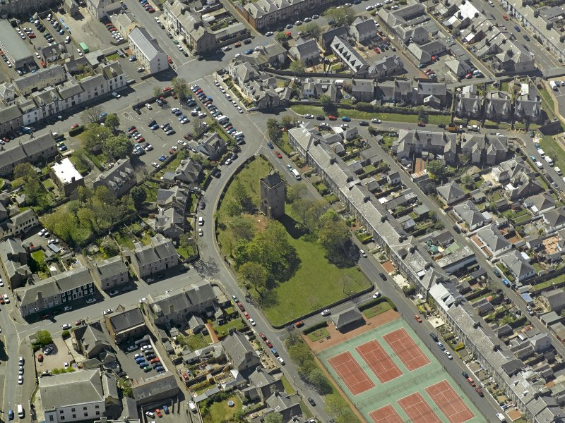 Oblique aerial view centred on St John's Tower, taken from the NE.