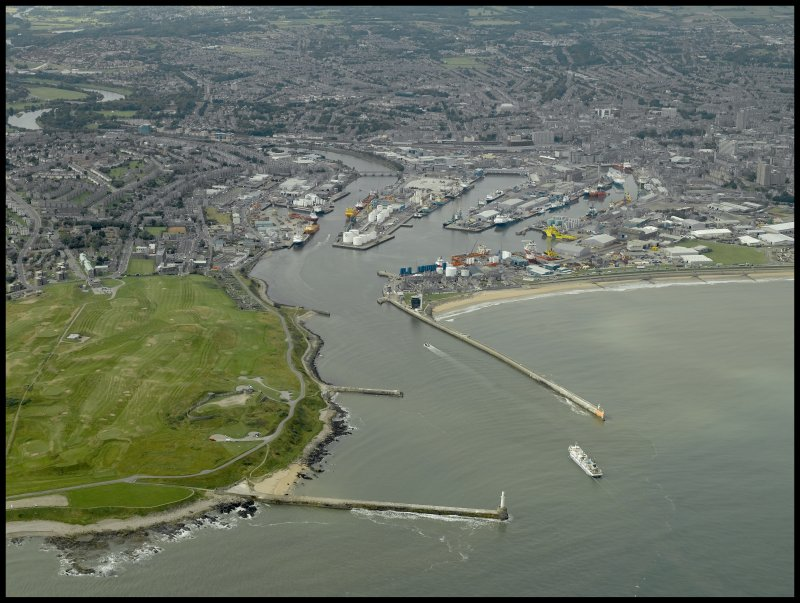 General oblique aerial view centred on the harbour, taken from the E.