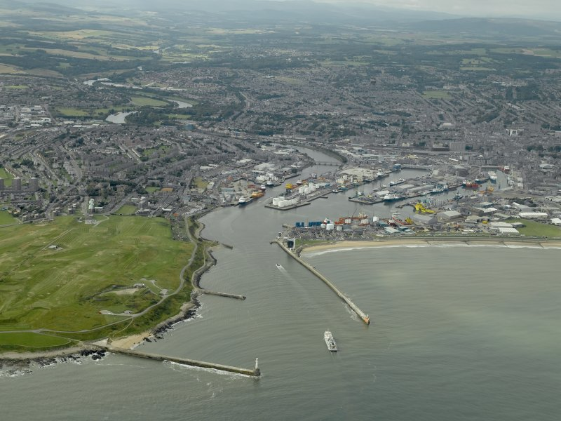 General oblique aerial view centred on the harbour, taken from the ENE.