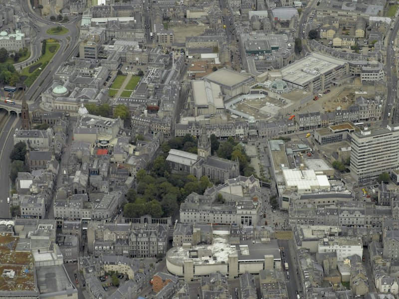 Oblique aerial view of the city centre centred on the Church of St Nicholas and Market Street, taken from the SE.