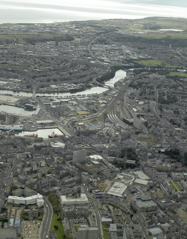 General oblique aerial view of the city centre centred on Guild Street station, taken from the NW.