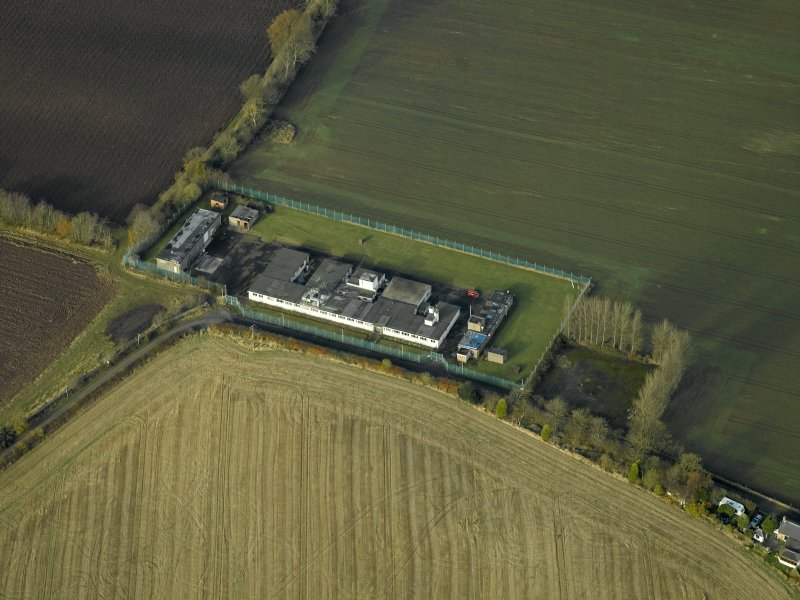 Oblique aerial view centred on the radar station, taken from the SE.