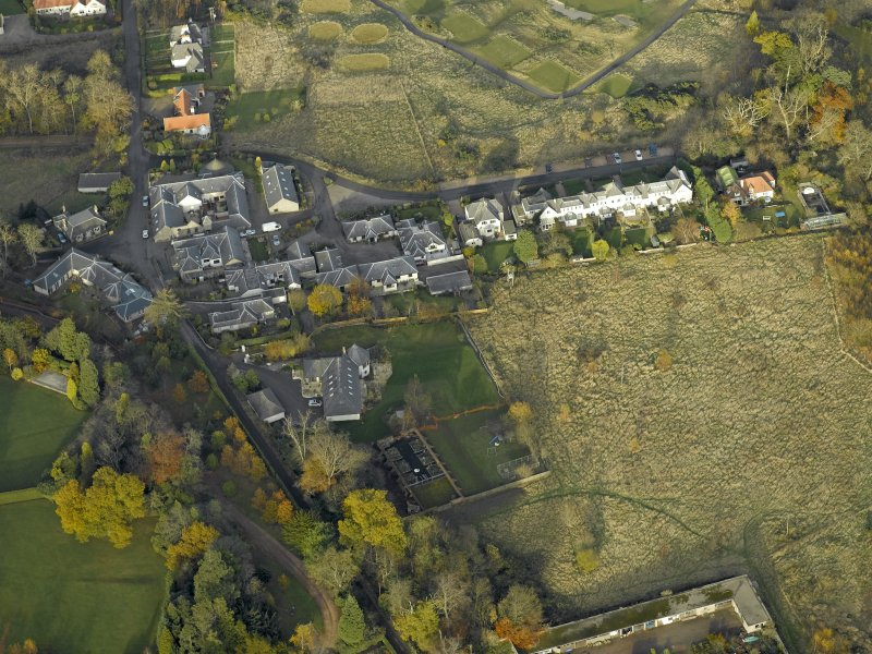 Oblique aerial view centred on the home farm, taken from the SSW.