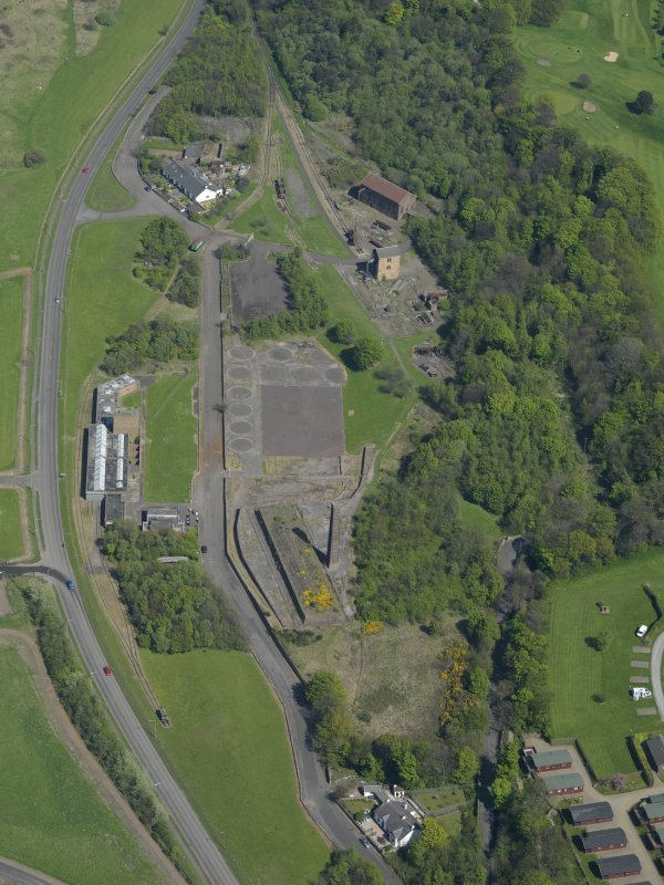Oblique aerial view centred on the Mining Museum, taken from the SW.