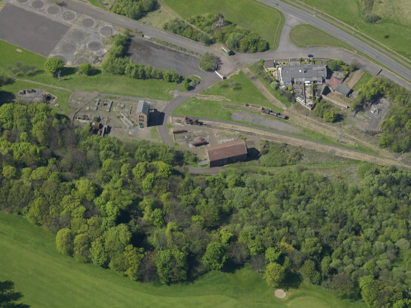 Oblique aerial view centred on the Mining Museum, taken from the SE.