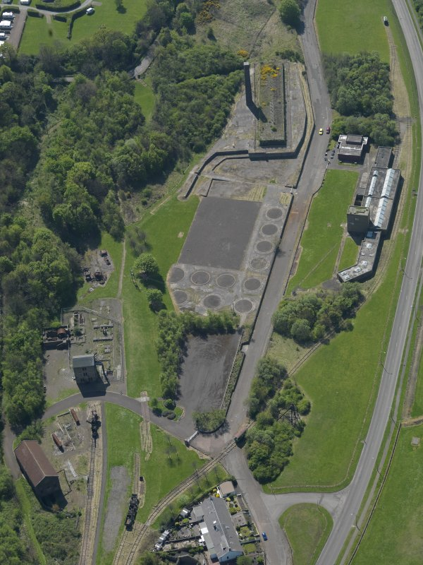 Oblique aerial view centred on the Mining Museum, taken from the NE.