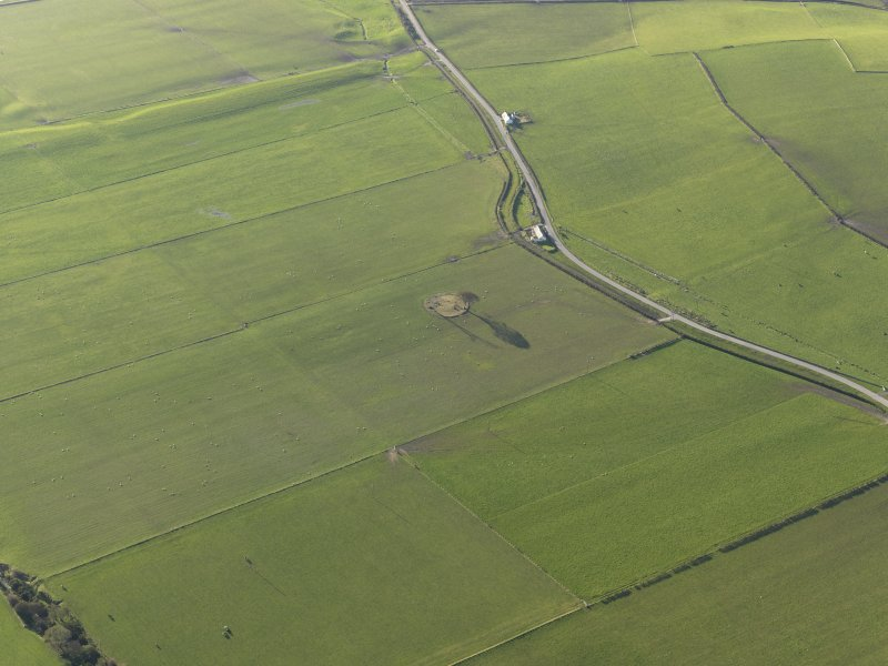 General oblique aerial view centred on the remains of the stone circle, taken from the NE.