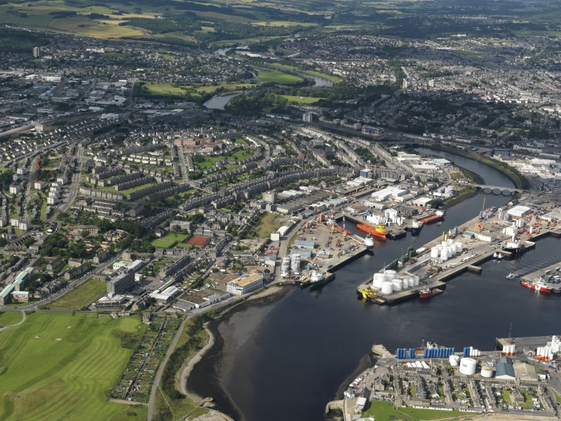 Oblique aerial view centred on the harbour area, taken from the ENE.