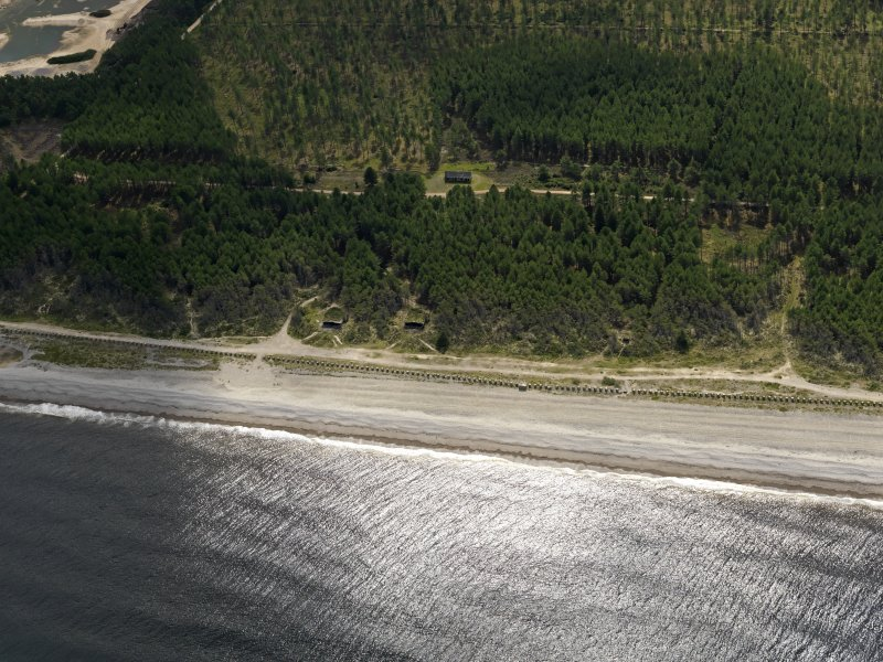 Oblique aerial view centred on the coast battery with the anti-tank blocks adjacent, taken from the NNW